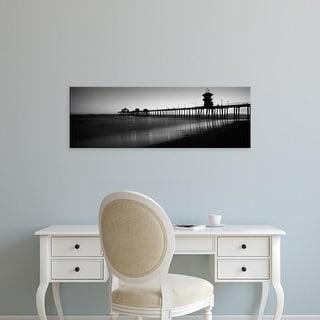 Easy Art Prints Panoramic Image 'Pier in sea, Huntington Beach Pier, Huntington Beach, Orange, California' Canvas Art