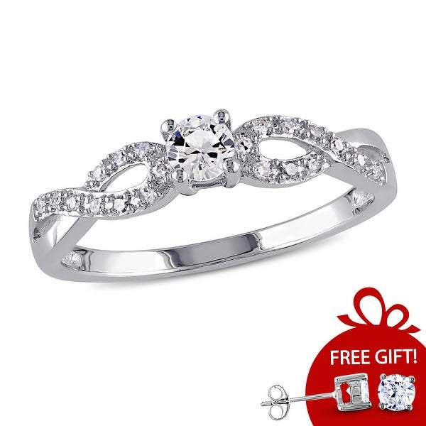 Miadora Sterling Silver Created White Sapphire and 1/10ct TDW Diamond Infinity Promise Ring. Opens flyout.