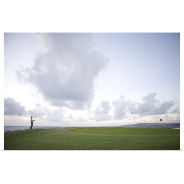 """""""Man at golf course holding golf club, looking away"""" Poster Print"""