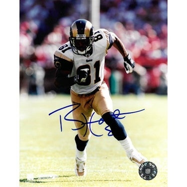 6011edc65 Shop Torry Holt signed St Louis Rams 8X10 Photo white jersey run ...