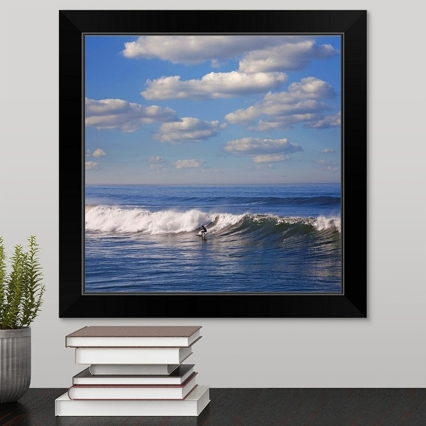 """Surfer riding big wave in Ocean beach, California."" Black Framed Print"