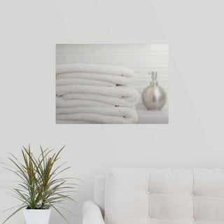 Poster Print entitled A stack of white towels in a bathroom with a soap dispenser (5 options available)