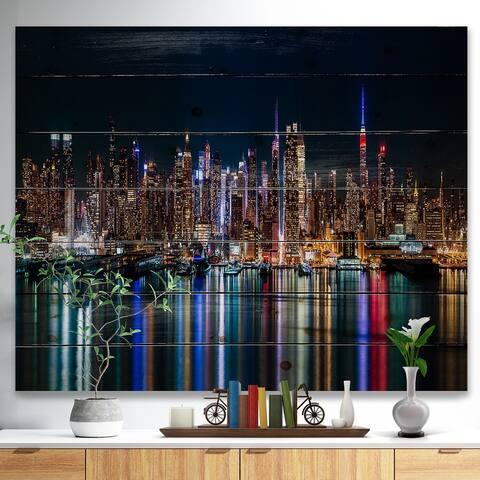 Designart 'New York Midtown Night Panorama' Print on Natural Pine Wood - Blue