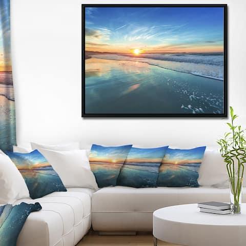 Designart 'Blue Seashore with Distant Sunset' Seascape Framed Canvas Art Print
