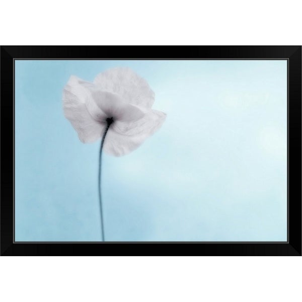 """""""A poppy seen from the stem with desaturated tones, against cool blue background."""" Black Framed Print"""