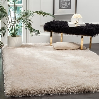 Link to Safavieh Handmade Luxe Shag Bahija Solid Polyester Rug Similar Items in Shag Rugs