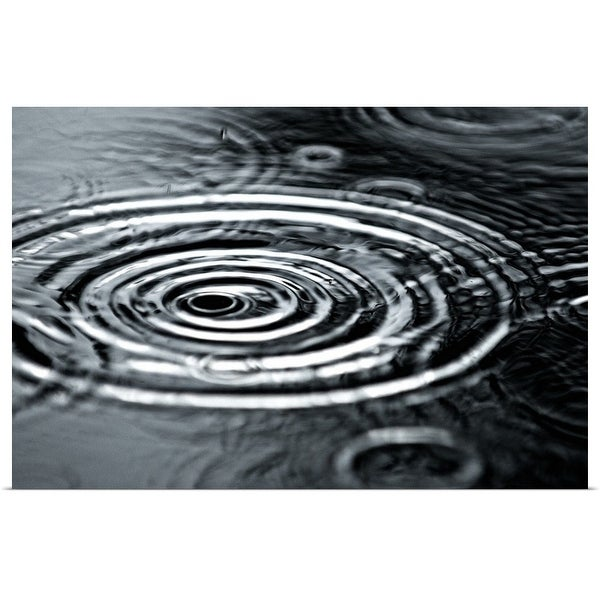 """""""Raindrops fall into a puddle during an afternoon rainstorm in Truckee, California."""" Poster Print"""