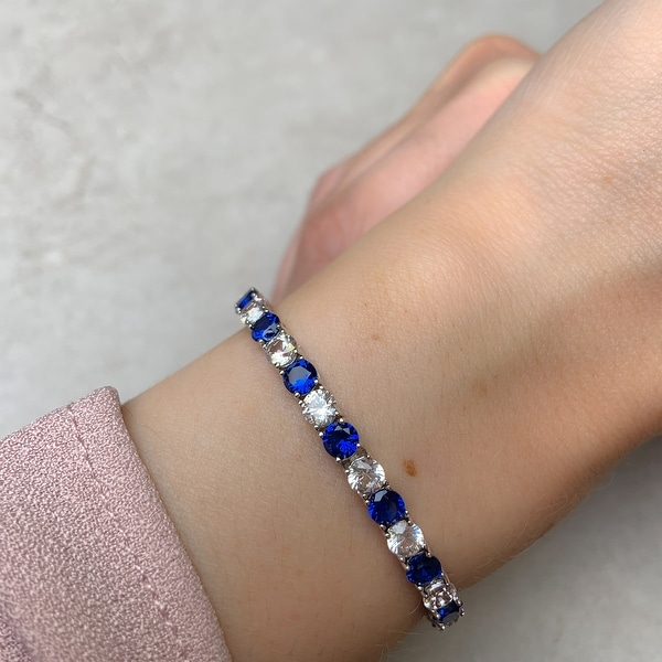 Miadora Sterling Silver Created Blue and White Sapphire Patterned Birthstone Tennis Bracelet - 7.25 in x 4.3 mm x 2.7 mm. Opens flyout.
