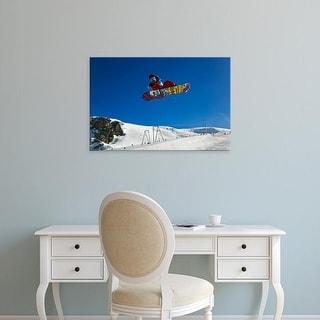 Easy Art Prints Adam Jones's 'Snowboarder Jumping In Halfpipe' Premium Canvas Art