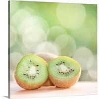 Premium Thick-Wrap Canvas entitled Kiwi fruit against bokeh background. - Multi-color