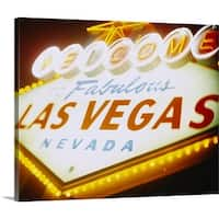 Premium Thick-Wrap Canvas entitled Low angle view of a welcome sign lit up at night, Las Vegas, Nevada - Multi-color