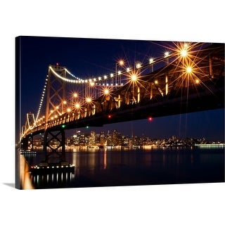 Premium Thick-Wrap Canvas entitled A burst of lights on the Bay Bridge and San Francisco skyline in the background.