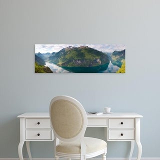 Easy Art Prints Panoramic Images's 'Reflection of mountains in fjord, Geirangerfjord, Sunnmore, Norway' Canvas Art