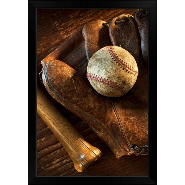 """Antique baseball on baseball glove with bat"" Black Framed Print"