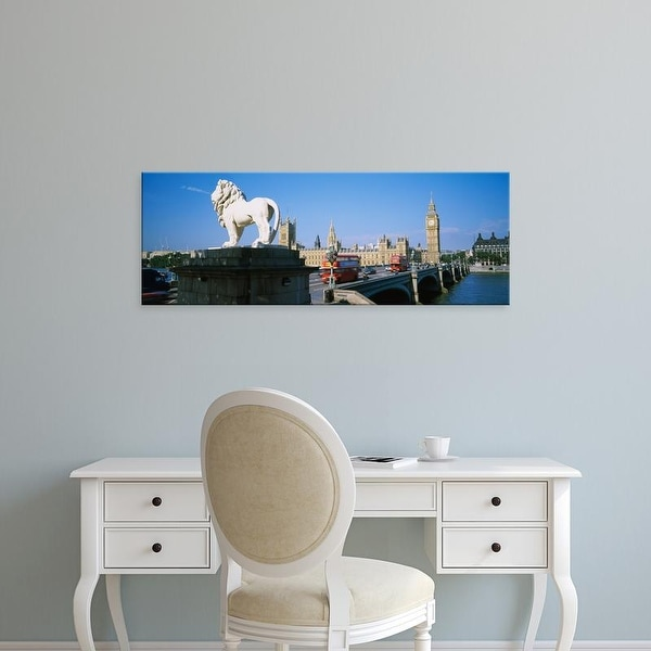 Easy Art Prints Panoramic Image 'Lion statue at an arched bridge, Houses Of Parliament, London, England' Canvas Art