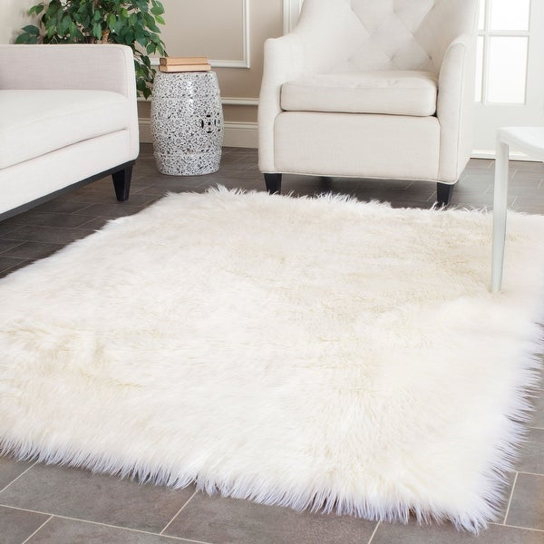 Safavieh Faux Sheep Skin Alexandria Shag Solid Rug. Opens flyout.