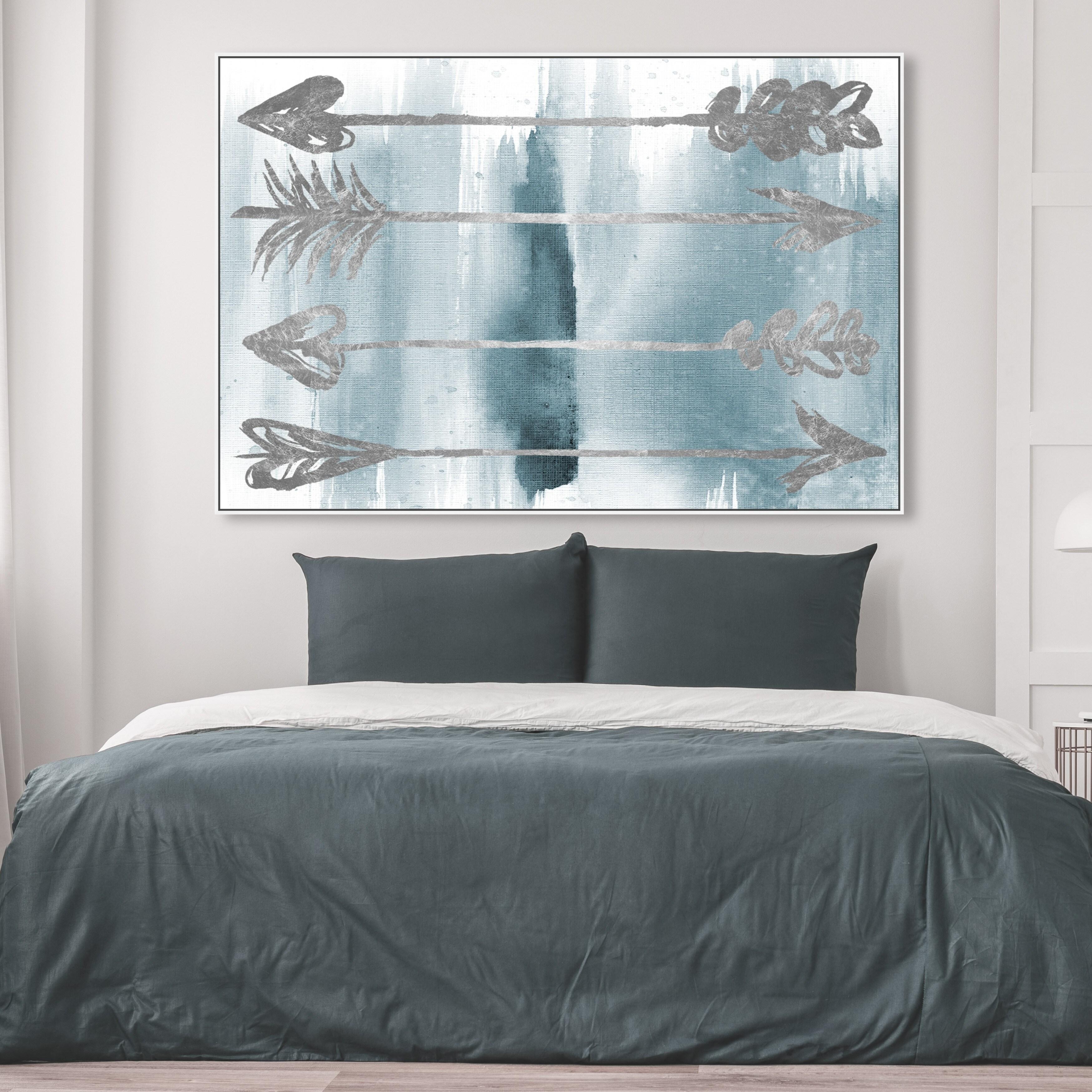 arrows as wall art in bedroom