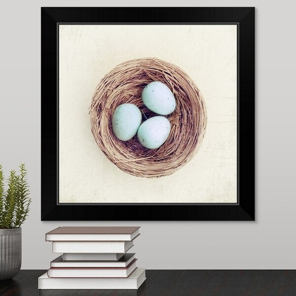 """""""Bird nest with blue baby robins eggs against neutral textured background."""" Black Framed Print"""