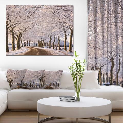 Designart 'Trees And Road in White Winter' Landscape Artwork Canvas Print