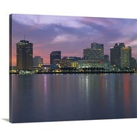 Premium Thick-Wrap Canvas entitled Buildings lit up at sunset, New Orleans, Louisiana