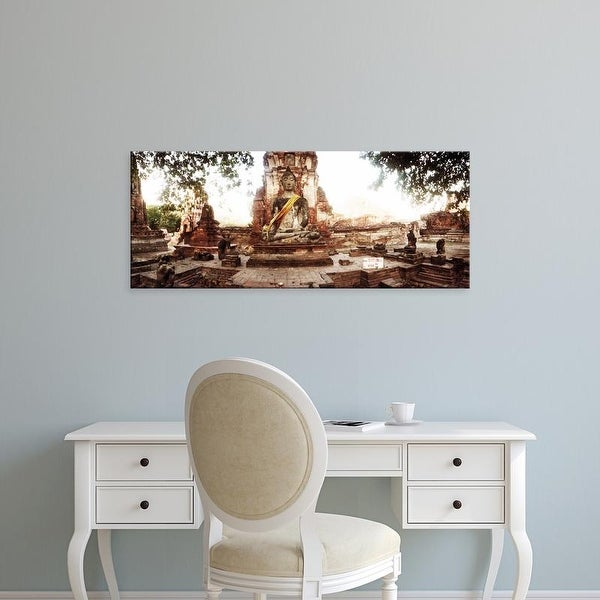 Easy Art Prints Panoramic Image 'Buddha statue, cloth and flowers, Ancient ruins of Ayutthaya, Thailand' Canvas Art