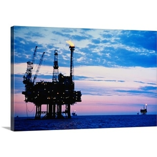 """""""Oil production platforms at dusk,  Forties Field, North Sea"""" Canvas Wall Art"""
