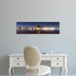 Easy Art Prints Panoramic Images's 'Buildings in a city lit up at dusk, Detroit River, Detroit, Michigan' Canvas Art