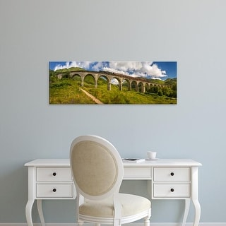 Easy Art Prints Panoramic Images's 'Steam train on old bridge, Scottish Highlands, Scotland' Premium Canvas Art