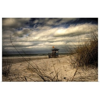 Poster Print entitled Empty moody beach with lifeguard hut - multi-color