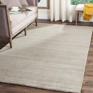 Link to Safavieh Handmade Himalaya Jessika Modern Wool Rug Similar Items in Living Room Furniture