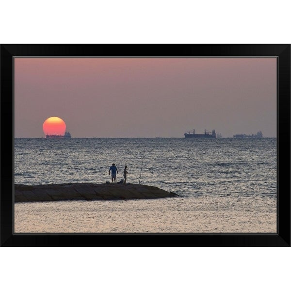 """""""Men fishing at Seawall Boulevard pier, with ships on their way to port, at sunrise"""" Black Framed Print"""