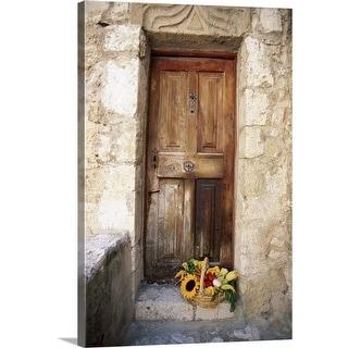 """Wooden door and basket of flowers"" Canvas Wall Art"