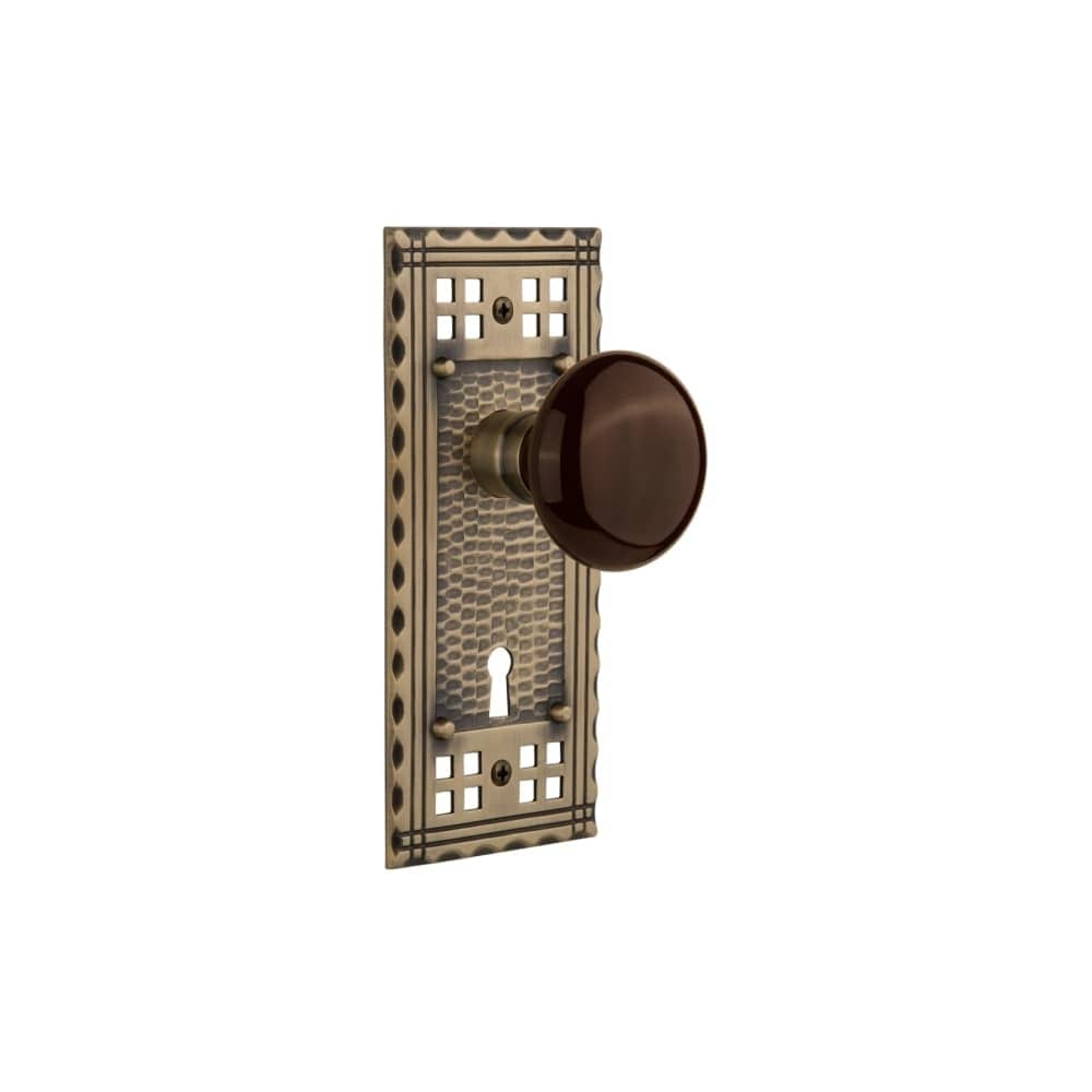 Nostalgic Warehouse CRABRN_DP_KH  Brown Porcelain Solid Brass Dummy Knob Set with Craftsman Rose and Keyhole (Timeless Bronze)