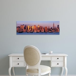 Easy Art Prints Panoramic Image 'New York City, West Side, Skyscrapers in a city during dusk' Canvas Art