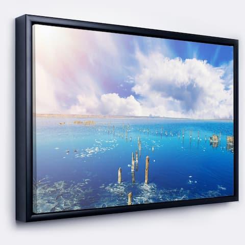 Designart 'Blue Salt Lake under Clouds' Large Seascape Art Framed Canvas Print