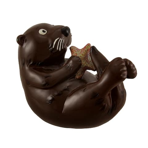 Swimming Sea Otter Holding Starfish Coin Bank