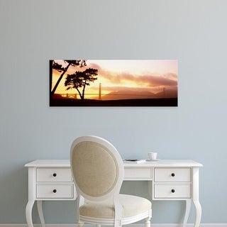Easy Art Prints Panoramic Image 'Ttrees at sunset, Golden Gate Bridge, San Francisco, California' Canvas Art