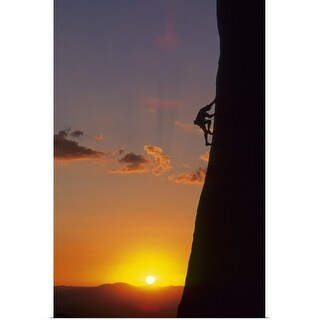 """Silhouette of man rock climbing at sunrise"" Poster Print"