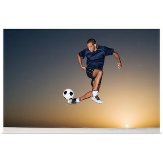 """""""Soccer player kicking ball in mid air"""" Poster Print"""