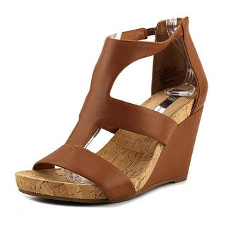 INC International Concepts Lilbeth Open Toe Synthetic Wedge Heel https://ak1.ostkcdn.com/images/products/is/images/direct/3a6819cfb3b7cca9c6caa9ef46535033c3ce4c02/INC-International-Concepts-Lilbeth-Women-Open-Toe-Synthetic-Tan-Wedge-Heel.jpg?impolicy=medium