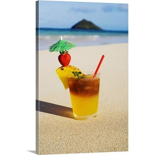 Premium Thick-Wrap Canvas entitled A mai tai garnished with pinapple and a strawberry, in the sand on the beach