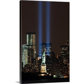Premium Thick-Wrap Canvas entitled World Trade Center Memorial lights and Statue of Liberty, New York City (4 options available)