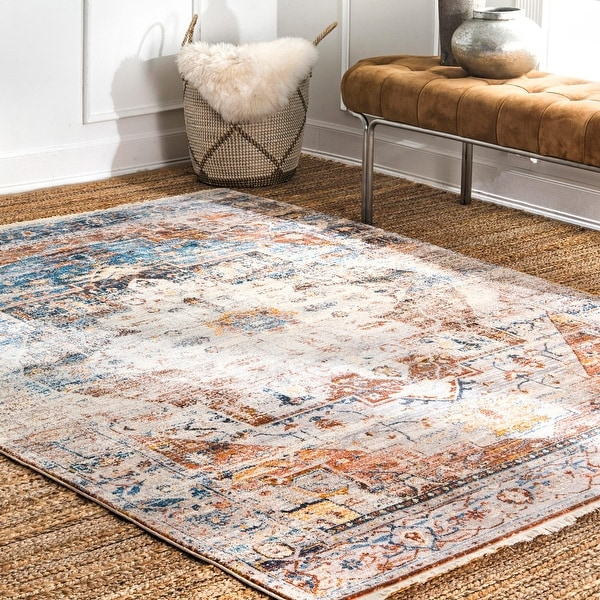 The Curated Nomad Dirk Vintage Tassel Border Area Rug. Opens flyout.