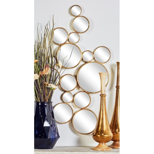 Strick & Bolton Buri Round Gold Wall Mirrors. Opens flyout.
