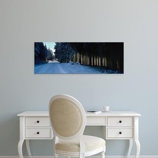 Easy Art Prints Panoramic Image 'Snow covered road, forest, Schwarzwalder Hochwald, Germany' Canvas Art