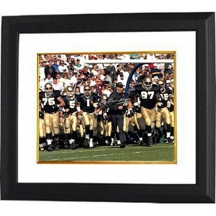 Lou Holtz signed Notre Dame Fighting Irish 16x20 Photo Custom Framed (silver sig-running with team under goal posts)- Steiner Ho