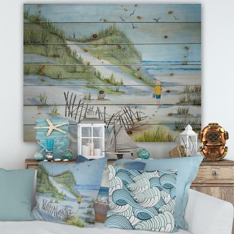 Designart 'Child Walking The Beach' Nautical & Coastal Print on Natural Pine Wood