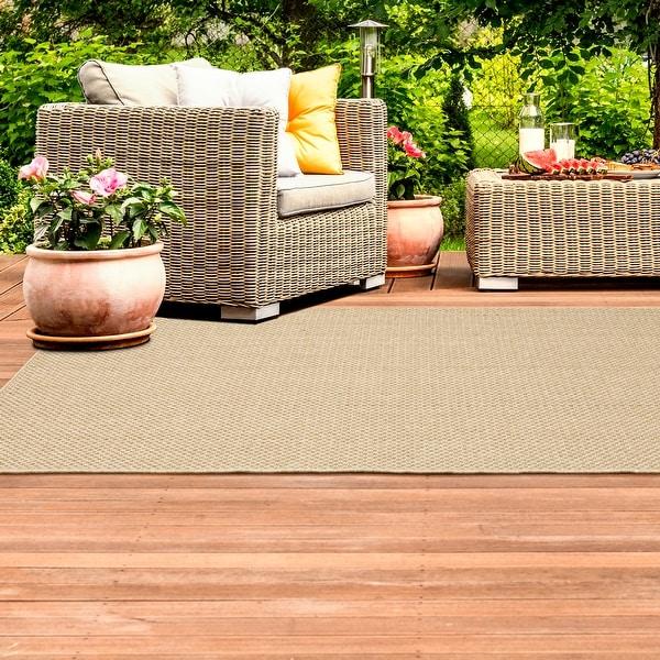 Veranda Woven Solid Sand Indoor-Outdoor Area Rug. Opens flyout.