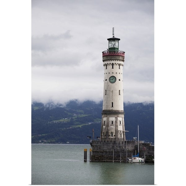 """""""old lighthouse on a pier of a lake with cloud covered mountains in the background"""" Poster Print"""