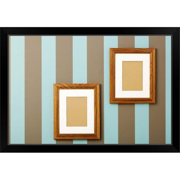 """""""Striped wallpaper with empty wood frames on walls"""" Black Framed Print"""